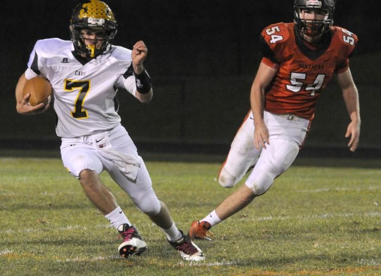 South Carroll's Aj Linn runs a quaterback keeper against North Carroll. (Ken Koons/Carroll County Times)