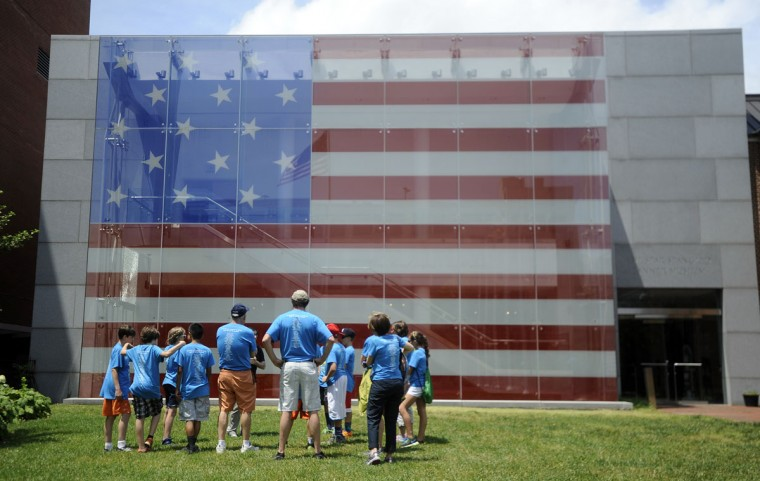 Visitors from Lambertsville (N.J.) Public School stand outside the Flag House and Star-Spangled Banner Museum, where Mary Pickersgill sewed the flag that flew over Fort McHenry and inspired the national anthem. (Baltimore Sun photo by Barbara Haddock Taylor, June 11, 2014)