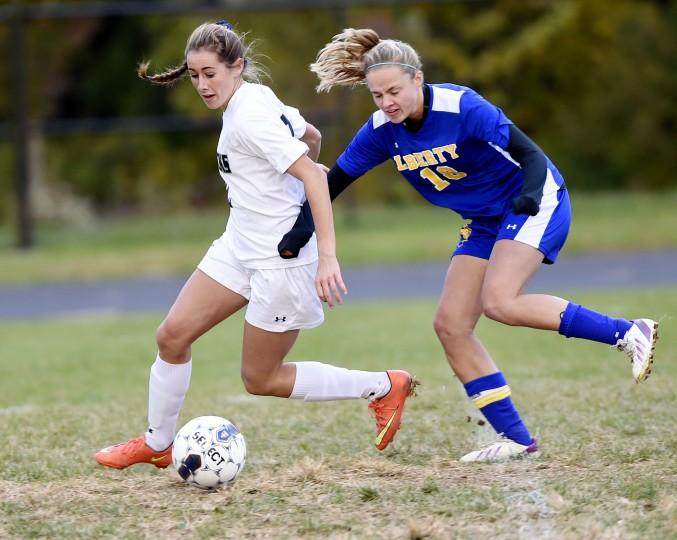 Manchester Valley's Lizzie Colson fights past Liberty's Sydney Hartman Saturday, Oct. 24. in Manchester. (Dave Munch/Carroll County Times)