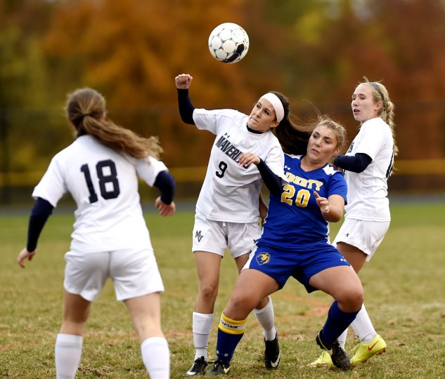 Manchester Valley's Kelsey Henneman fights for a ball in the air with Liberty's Jordan Cassatt Saturday, Oct. 24. in Manchester. (Dave Munch/Carroll County Times)