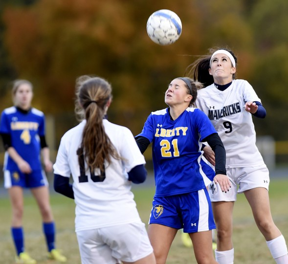 Manchester Valley's Kelsey Henneman fights for a ball in the air with Liberty's Emily Garrick Saturday, Oct. 24. in Manchester. (Dave Munch/Carroll County Times)