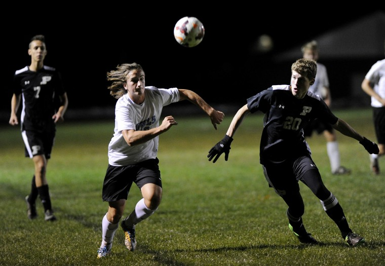 Westminster's Blake Ruby fights for a ball in the air with Poolesville's Hayden Sabas Thursday, Oct. 29 in Westminster. (Dave Munch/Carroll County Times)