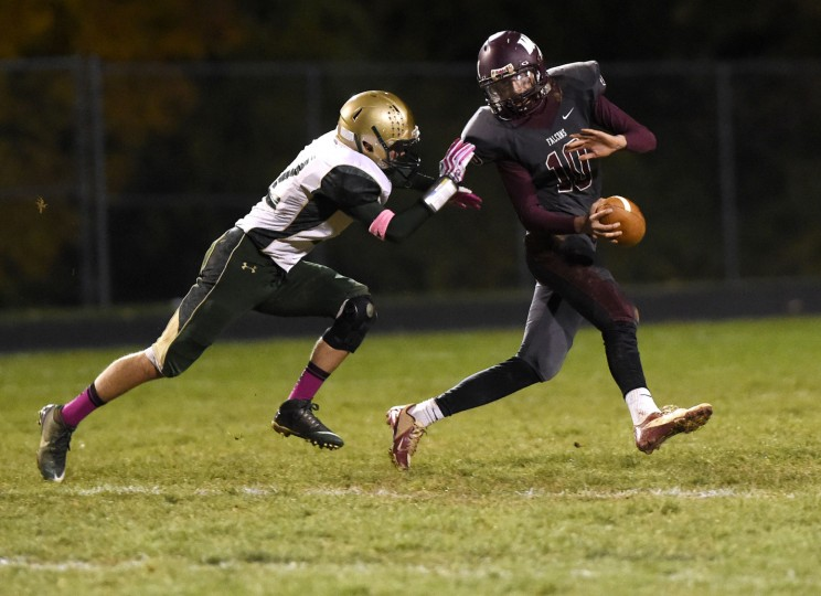 Winters Mill quarterback Patrick Brown is sacked by Century's Jarrett Justice Friday, Oct. 23 in Westminster. (Dave Munch/Carroll County Times)