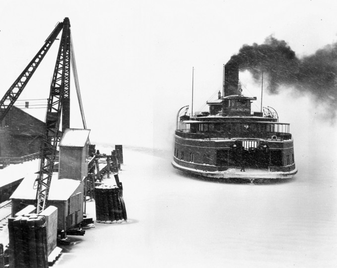 "1934 - The ""Philadelphia"" (affectionately known as ""Smoky Joe""), a ferry that traveled between Baltimore and Love Point on Kent Island, pulls in to Pier 5 off Light street during a 1934 snowstorm. (A. Aubrey Bodine/Baltimore Sun)"