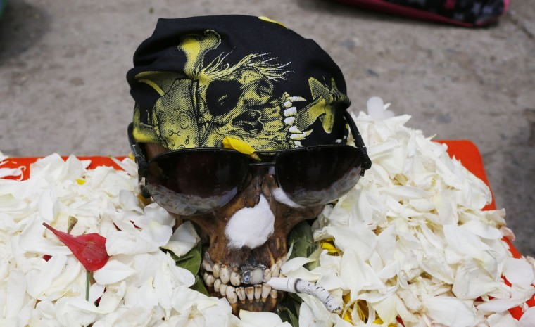 "A human skull or ""natitas"" with glasses is displayed outside the Cementerio General chapel, during the Natitas Festival, in La Paz, Bolivia, Sunday, Nov. 8, 2015. Although some natitas have been handed down through generations, many are from unnamed, abandoned graves that are cared for and decorated by faithful who use them as amulets believing they serve as protection. The tradition marks the end of the Catholic All Saints holiday, but is not recognized by the Catholic church. (AP Photo/Juan Karita)"
