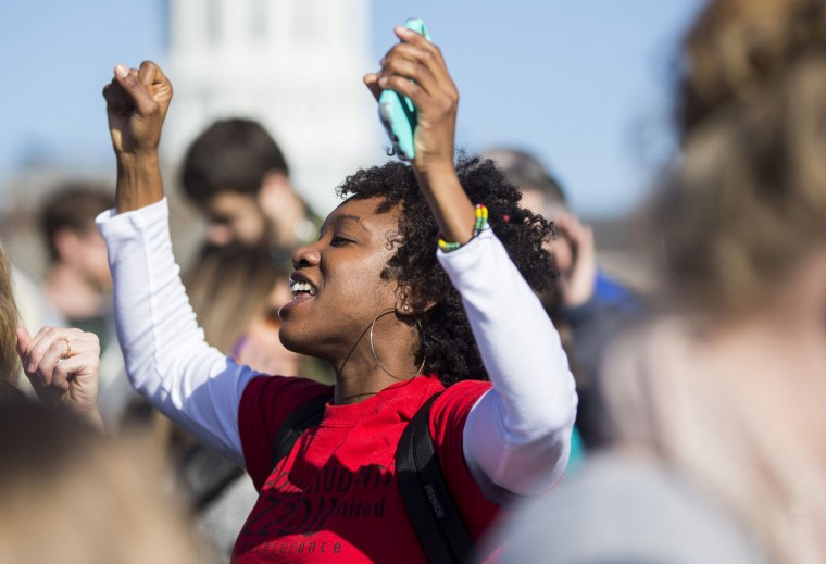 Protesters celebrate the resignation of University of Missouri president Timothy M. Wolfe on the University of Missouri campus November 9, 2015 in Columbia, Missouri. Wolfe resigned after pressure from students and student athletes over his perceived insensitivity to racism on the university campus. (Brian Davidson/Getty Images)