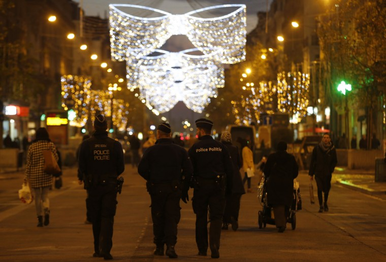 Belgian police on patrol in central Brussels at dusk on Monday, Nov. 23, 2015. Three days of the highest terror alert and unprecedented measures that have closed down the city's subways, schools and main stores, has created a very different atmosphere as the Belgian capital tries to avoid attacks similar to the ones that caused devastating carnage in Paris. (AP Photo/Alastair Grant)
