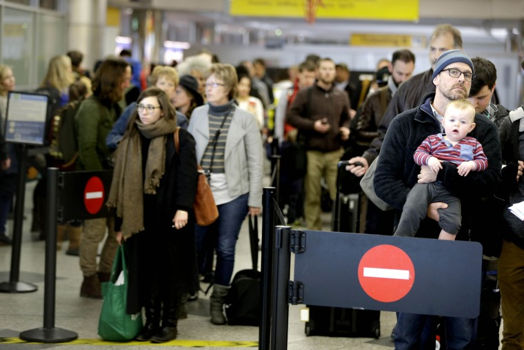 Travelers wait to go through security at LaGuardia Airport in New York, Tuesday, Nov. 24, 2015. (AP Photo/Seth Wenig)