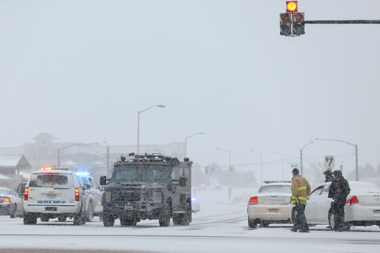 An armored police vehicle transports hostages to safety during an active shooter situation outside a Planned Parenthood facility where an active shooter reportedly injured up to eleven people, including at least five police officers, on November 27, 2015 in Colorado Springs, Colorado. Police are working to clear the scene and are searching the building for possible explosive devices. (Justin Edmonds/Getty Images)