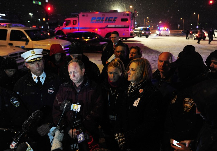 Colorado Springs, Colo., Mayor John Suthers, second from left, talks to media after a deadly shooting at a Planned Parenthood clinic Friday, Nov. 27, 2015, in Colorado Springs, Colo. (Daniel Owen/The Gazette via AP)