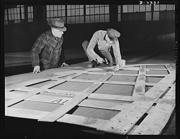 These are shell frames and deck brackets ready to be welded between deck beams and frames for ship of the Liberty Fleet under construction at a large Eastern yard. All parts are prefabricated in this huge Eastern plant which formerly turned out freight cars. The completed sections are then carried six miles to the ways on flat cars. Bethlehem-Fairfield Shipyards Inc., Baltimore, Maryland