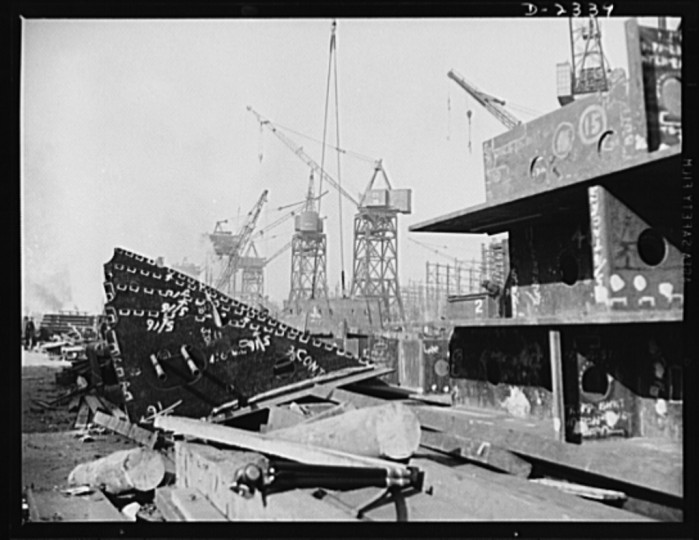 Here are prefabricated tanks and deck girder sections ready to be hoisted up and set in their place in one of the new merchant ships under construction in a large Eastern shipyard. Bethlehem-Fairfield Shipyards Inc., Baltimore, Maryland