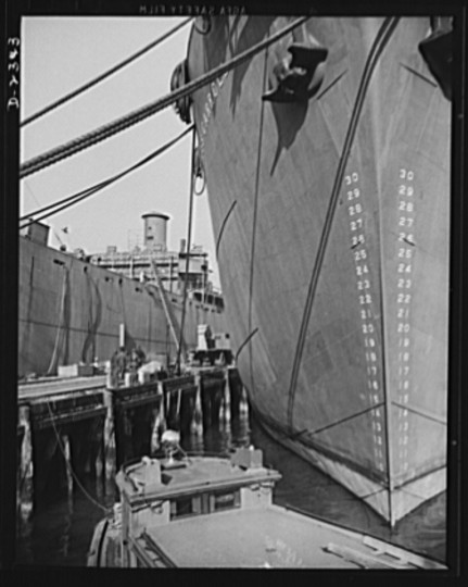 Here are two members of the Liberty Fleet lying at anchor in the basin of a large Eastern shipyard, awaiting final fitting and rigging. Bethlehem-Fairfield Shipyards Inc., Baltimore, Maryland