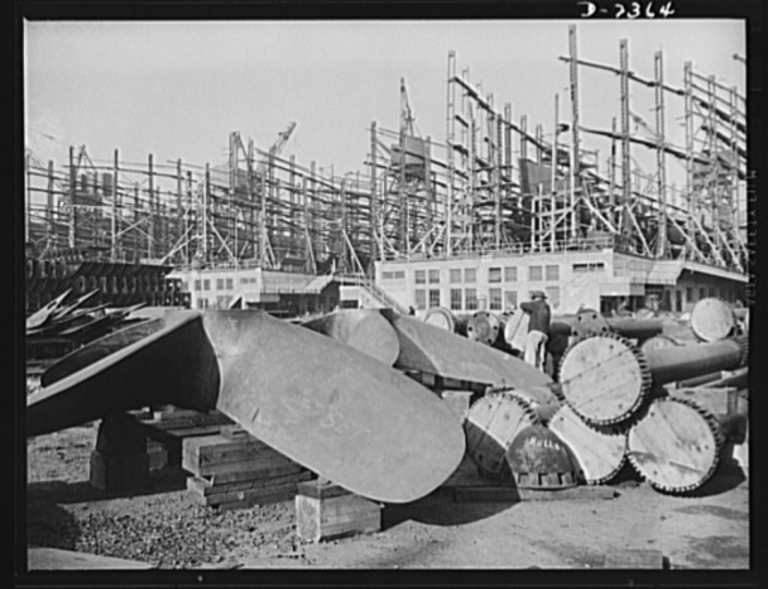 The propellers and shafting pieces are awaiting installation in the ships of the Liberty Fleet being built at a large Eastern shipyard