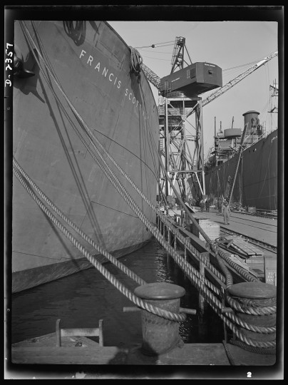 Here are two members of the Liberty Fleet lying at anchor in the basin of a large Eastern shipyard, awaiting final fitting and rigging