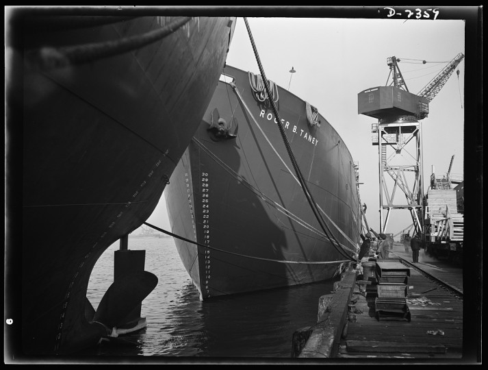 Here are two members of the Liberty Fleet lying at anchor in the basin of an Eastern shipyard, awaiting final fitting and rigging. Bethlehem-Fairfield Shipyards Inc., Baltimore, Maryland