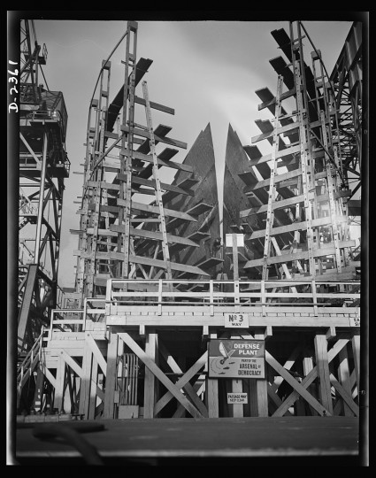 This is the bow of a new Liberty Fleet member, awaiting its hose or template at a large Eastern shipyard. Bethlehem-Fairfield Shipyards Inc., Baltimore, Maryland