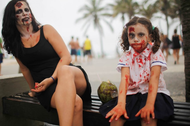 Revelers pose on Ipanema beach during Day of the Dead festivities on November 2, 2015 in Rio de Janeiro, Brazil. Brazilians often mark the traditional Mexican holiday by visiting loved ones' graves and sometimes leaving offerings of food or drink. Many revelers came to Ipanema beach during a 'Zombie Walk'. (Mario Tama/Getty Images)
