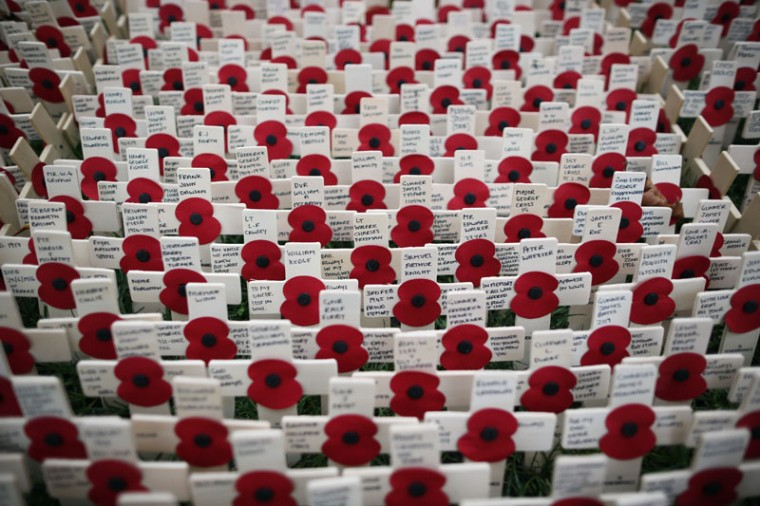 Remembrance crosses stand in the Field of Remembrance outside Westminster Abbey ahead of its official opening, on Tuesday, in London. Hundreds of small crosses bearing a poppy are being planted in the Field of Remembrance to pay tribute to British servicemen and women who have lost their lives in conflict. (Dan Kitwood/Getty Images)