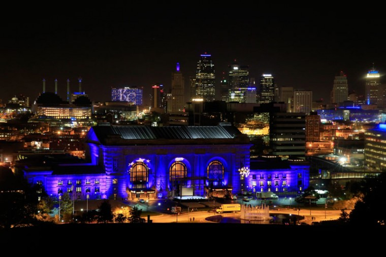 Union Station is lit up with blue lights in front of the Kansas City skyline on ahead of a parade and celebration in honor of the Kansas City Royals' World Series win.  (Jamie Squire/Getty Images)