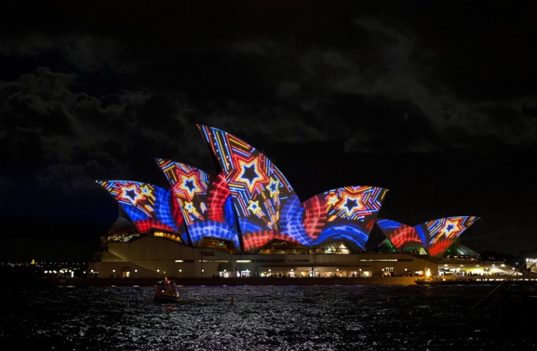 The Sydney Opera House is lit up by a projection during Vivid Sydney, the annual festival of light, music and ideas, in Sydney on May 24, 2013. More than 60 interactive and immersive light sculptures and installations across Circular Quay, The Rocks, Walsh Bay, Darling Harbour and North Sydney took part in the festival. City skyscrapers were lit along with 3D mapped projections on Customs House, Museum of Contemporary Art Australia, and Cadman's Cottage. The inaugural Light City Baltimore is modeled after the Sydney festival. (SAEED KHAN/AFP/Getty Images)