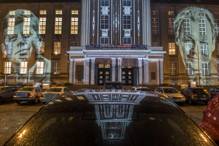 """Giant portraits of former U.S. President John F Kennedy and German Chancellor Willy Brandt are cast on the facade of the town hall of the Schoeneberg district in Berlin on Oct. 14 as part of the Berlin Leuchtet light festival. The town hall of the Tempelhof-Schoeneberg borough of the German capital was the seat of the West Berlin state senate until 1991 and is the venue where US President Kennedy made his famous speech in the then-divided city on June 26th, 1963 declaring """"Ich bin in Berliner."""" (ODD ANDERSEN/AFP/Getty Images)"""