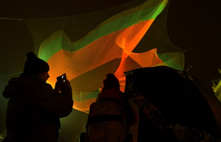 People take pictures of a seven-meter installation by U.S. artist Janet Echelman during the Signal Festival on Oct. 15 in Prague, Czech Republic. (MICHAL CIZEK/AFP/Getty Images)