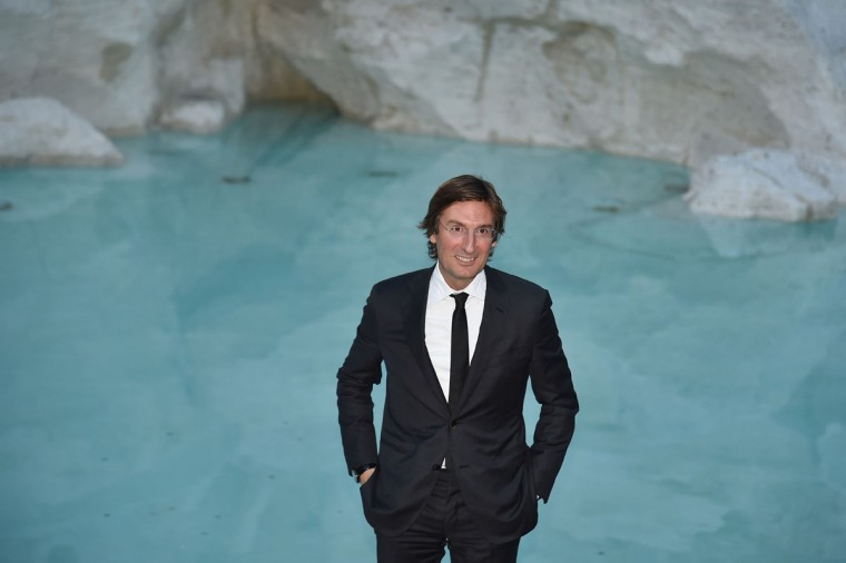 Fendi's Ceo, Pietro Beccari, poses in front of the restored Trevi fountain prior its inauguration on November 3, 2015 in central Rome. (ALBERTO PIZZOLI/AFP/Getty Images)