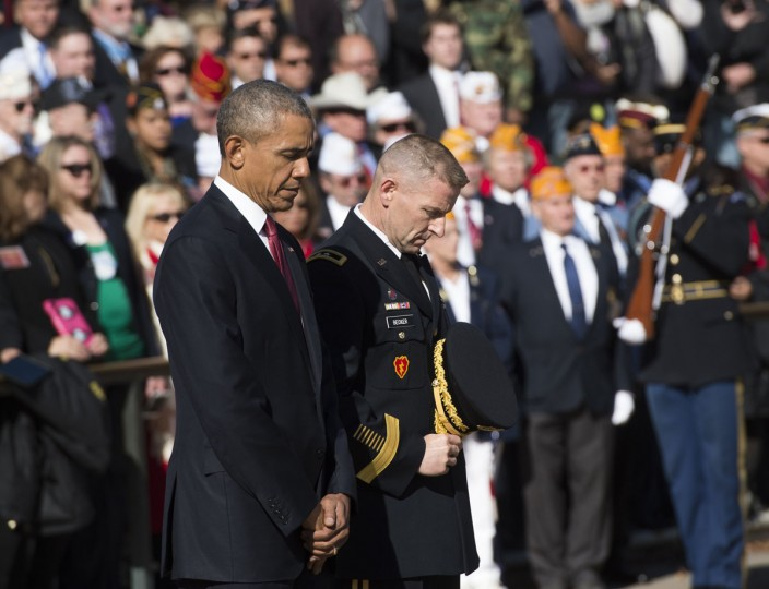 "President Barack Obama pauses for the playing of ""Taps""as he participates in a wreath laying ceremony at the Tomb of the Unknown Soldier in honor of Veteran's Day at Arlington National Cemetery in Arlington, Virginia, November 11, 2015. Alonside the President is US Army Maj. Gen. Bradley A. Becker, Commanding General JFHQ-NCR/MDW. (AFP Photo/Saul Loeb)"