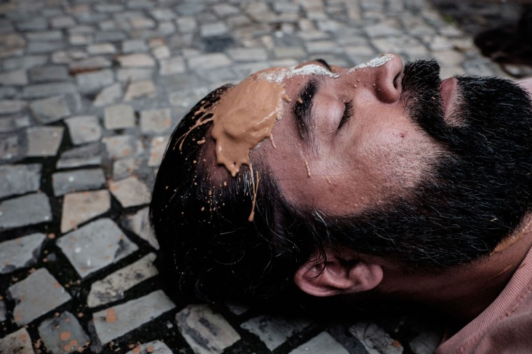 A protester performs in front of Brazilian mining company Vale headquarters in Rio de Janeiro, Brazil, on November 16, 2015. The bursting of two dams at a mine operated by Brazilian company Samarco - equally owned by Vale and Australian BHP Billiton- unleashed torrents of waste that flattened a village in Minas Gerais State on November 5 killing ten people. Brazilian mining firm Samarco promised Monday to pay at least $260 million for damage from the bursting, prosecutors said. (YASUYOSHI CHIBA/AFP/Getty Images)