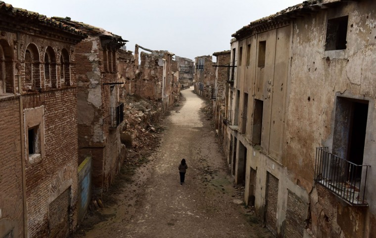 Tour guide Pilar walks down the central street through the ruins of Belchite village, in Aragon on November 12, 2015. (GERARD JULIEN/AFP/Getty Images)