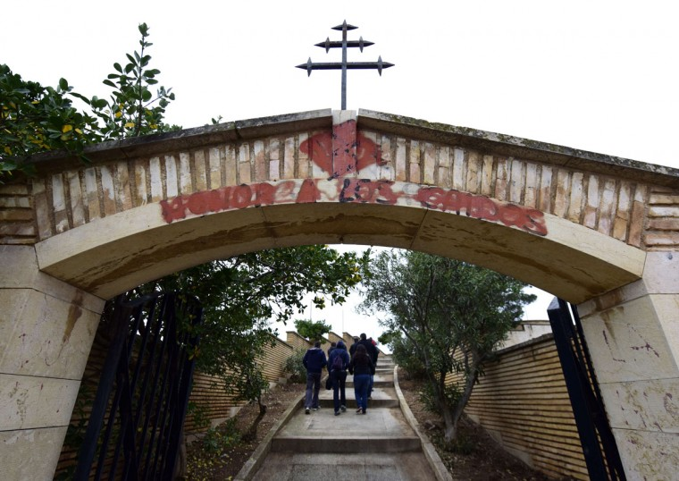 "Visitors walk through the entrance to the republican mausoleum bearing the inscription, disappeared ""Honor a los caidos"" (Honor to the fallen) in the village of Belchite, Aragon, on November 12, 2015. (GERARD JULIEN/AFP/Getty Images)"