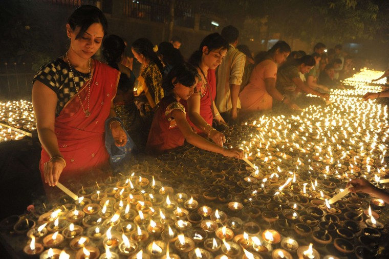 Indian Hindu devotees perform a ritual by lighting diyas - earthen lamps - on the occasion of Karthika month in Hyderabad ,on November 25, 2015. (NOAH SEELAM/AFP/Getty Images)