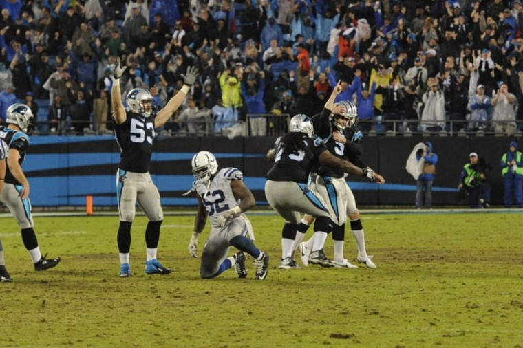 Teammates surround Carolina Panthers kicker Graham Gano after his game-winning field goal in overtime against the Indianapolis Colts in Charlotte, N.C., early Tuesday, Nov. 3, 2015. (Mike McCarn/AP)