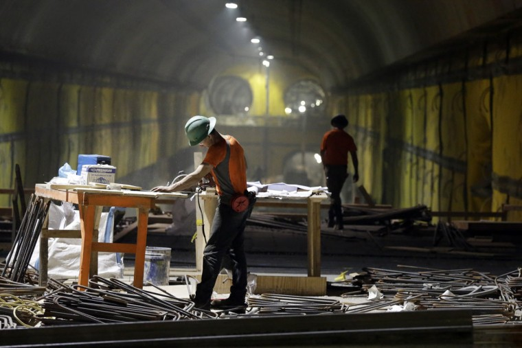 Contractors work on the East Side Access project beneath midtown Manhattan, Wednesday, Nov. 4, 2015, in New York. When completed, the East Side Access will allow the MTA's Long Island Rail Road passengers to get off on Manhattan's East Side at Grand Central Terminal from Long Island through a Queens station linked to the 120-foot tunnel. The target completion date is 2022. (AP Photo/Mary Altaffer)
