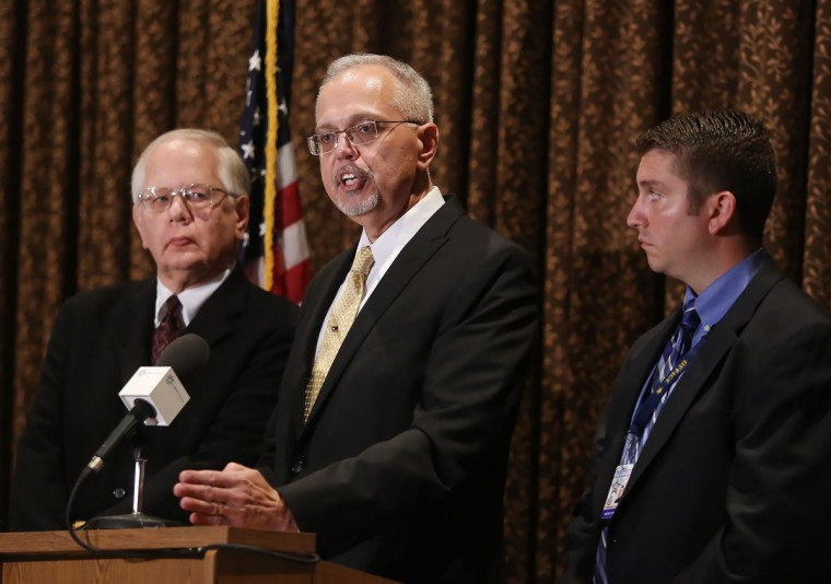 Lake County Coroner Dr. Thomas Rudd, left, Lake County Major Crime Task Force Cmdr. George Filenko, center, and Lake County sheriff's Detective Chris Covelli confirm that Fox Lake Lt. Charles Joseph Gliniewicz, 52, died Sept. 1 of a self-inflicted gunshot wound, during a press conference Wednesday, Nov. 4, 2015, in Round Lake Beach, Il. Gliniewicz carefully staged his death to make it look like he was killed in the line of duty and had been stealing for years from a youth program he oversaw, authorities said Wednesday.(Gilbert R. Boucher II/Daily Herald via AP)
