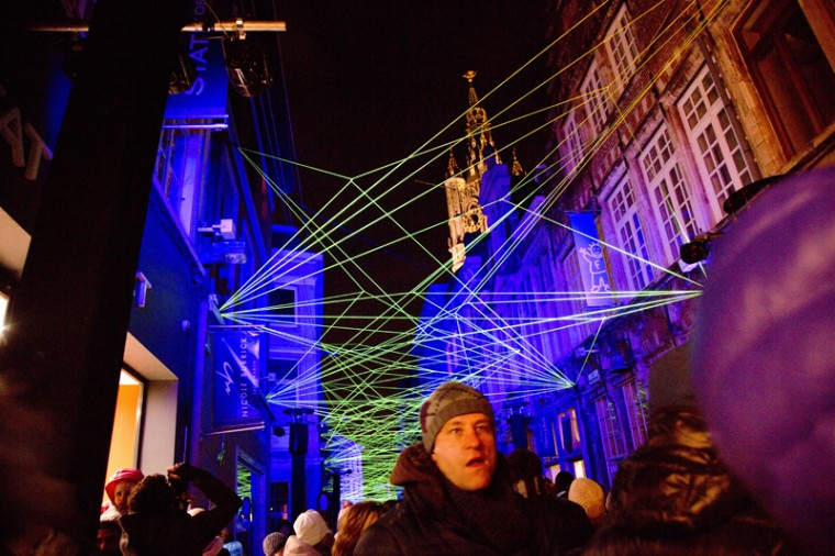 Visitors walk down an alley with a light projection display during the light festival in Ghent, Belgium on Feb. 1. (Virginia Mayo/AP)