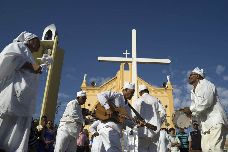 A group devoted of Saint GonÁalo dance in front the Perpetuo Socorro church during Day of the Dead celebrations, in Juazeiro do Norte, Brazil, Monday, Nov. 2, 2015. The Portuguese saint is usually celebrated with a dance that is offered all the souls. (Leo Correa/AP photo)