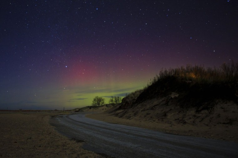 The Northern Lights/Aurora Borealis appear over Ludington State Park around 2:40 a.m. Tuesday in Ludington, Mich. (Joel Bissell/MLive.com via AP)