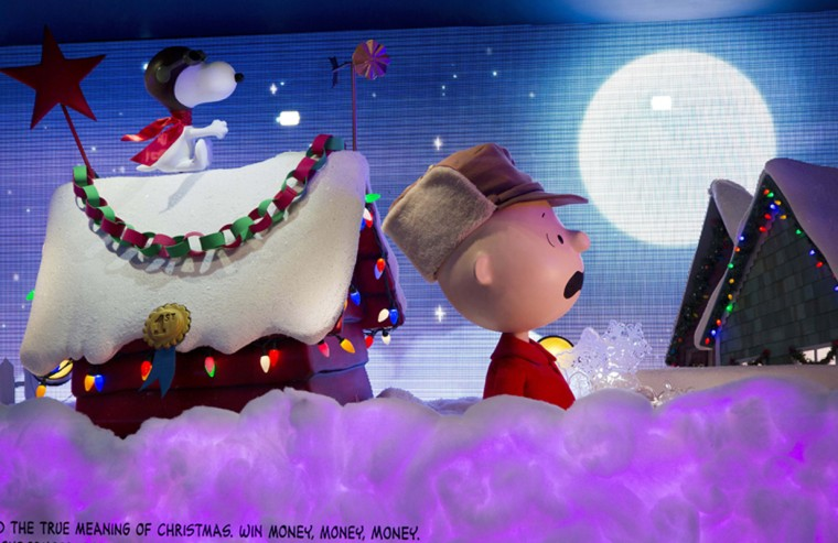Comics characters Snoopy, left, and Charlie Brown are displayed in a holiday window display at Macy's on Tuesday in New York. (Mark Lennihan/AP)