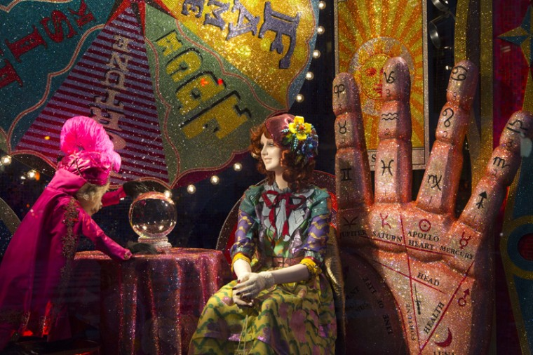 A fortune teller display appears in a holiday window at Bergdorf Goodman, Tuesday, Nov. 24, 2015 in New York. Many New York stores participate in the seasonal ritual of window display pageantry. (Mark Lennihan/AP)