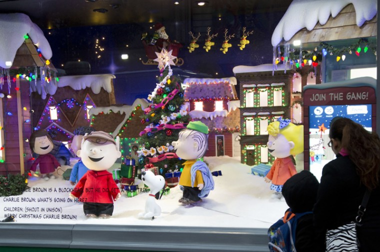 People stop to look at Peanuts characters displayed in a holiday window at Macy's, on Tuesday in New York. (Mark Lennihan/AP)