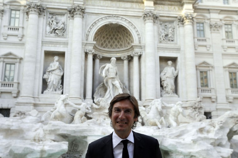 "Fendi CEO Pietro Beccari poses for the photographers in front of the newly restored Trevi Fountain during the official inauguration in Rome, Tuesday, Nov. 3, 2015. The historical fountain, famed as a setting for the film ""La Dolce Vita'' and the place where dreamers leave their coins, reopened after a 17-months restoration financed by the Fendi fashion house. (AP Photo/Gregorio Borgia)"