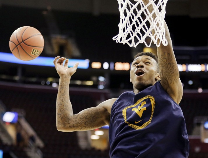 """Name: Daxter Miles Jr. College: West Virginia Position: Guard Year: Sophomore High school: Dunbar Hometown: Baltimore 2014-15 stats: 7.3 points, 2.3 rebounds, 20.5 minutes, 40.8% FG Miles was immediately a fixture in the Mountaineers' lineup, starting all 35 games for a West Virginia team that made the Sweet 16. An Academic All-Big 12 Rookie Team honoree, Miles scored 12 points in WVU's NCAA second-round win over Maryland. Coach Bob Huggins told CBS Sports that Miles is one of two Mountaineers that he expects to make """"the biggest jump"""" this season. Associated Press photo by Tony Dejak"""