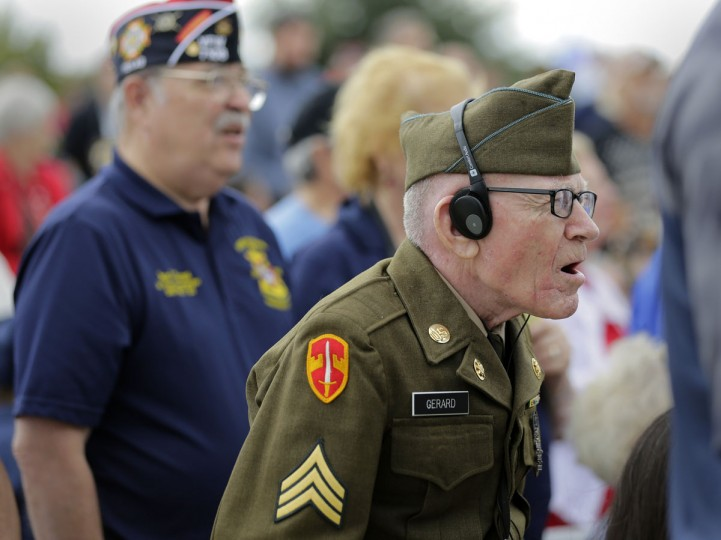 Army veteran James F. Gerald, 85, right, sings the National Anthem during a Veteran's Day observance at Fort Sam Houston National Cemetery, Wednesday, Nov. 11, 2015, in San Antonio. (AP Photo/Eric Gay)