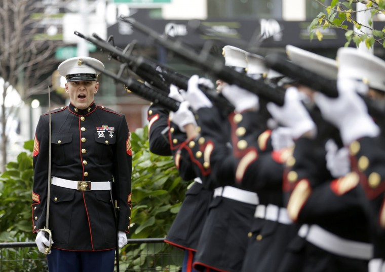 Marines perform a 21 gun salute before the start of the annual Veteran's Day parade in New York, Wednesday, Nov. 11, 2015. (AP Photo/Seth Wenig)