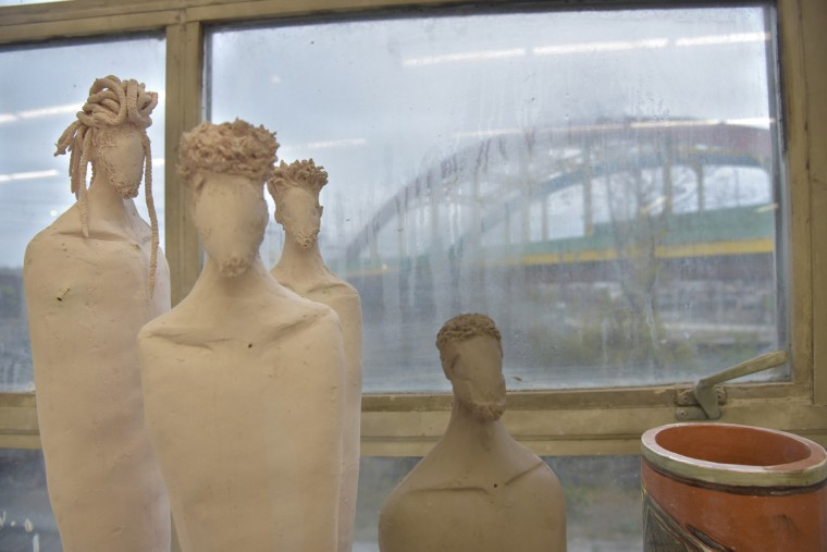 These are unfired ceramic male figures. Merriweather's figure work focuses on African American culture with an emphasis on natural hair.  (Algerina Perna/Baltimore Sun)