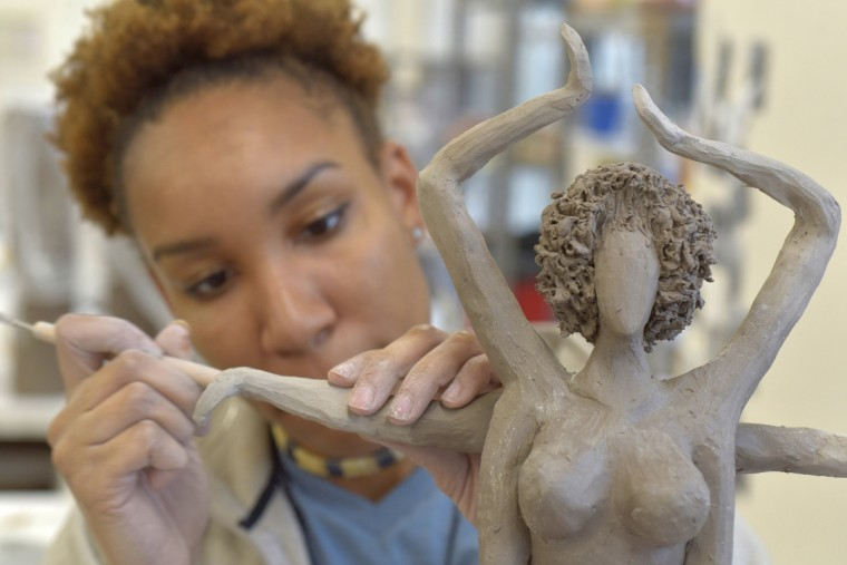 Murjoni Merriweather works on her art at the MICA ceramics studio. A sophomore ceramics student, Merriweather's figure work focuses on African American culture.  (Algerina Perna/Baltimore Sun)