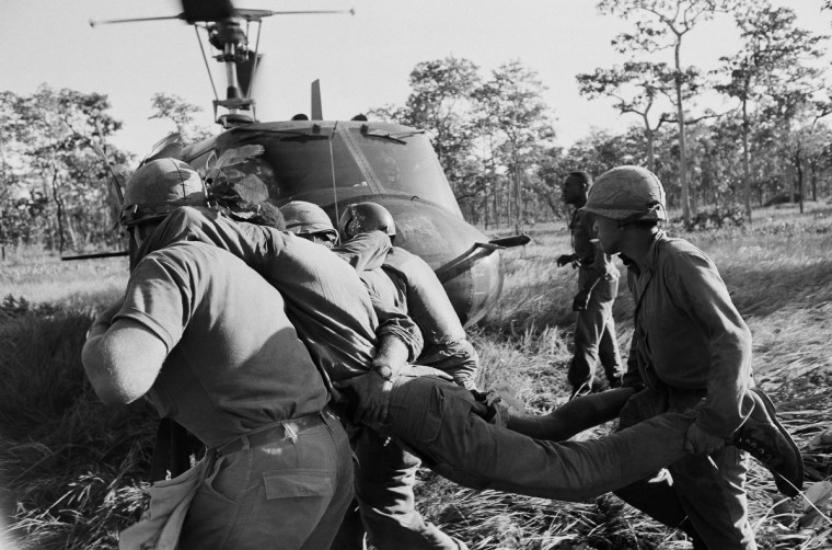 A U.S. cavalryman seriously wounded Nov. 17, 1965 when his battalion was ambushed by North Vietnamese in South Vietnam's Ia Drang Valley, is carried by medics and helicopter crewmen to an ambulance helicopter during Nov. 18, 1965 evacuation of the wounded soldiers.  A battalion of the U.S. 1st Air Cavalry Division was ambushed while marching from the jungle clearing where the Ia Drang Valley fighting started on November 14, 1965.  (AP Photo)