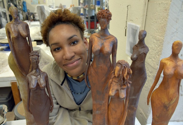 Murjoni Merriweather is inspired by Swiss artist Alberto Giacometti's elongated forms in creating her own ceramic figures. (Algerina Perna/Baltimore Sun)